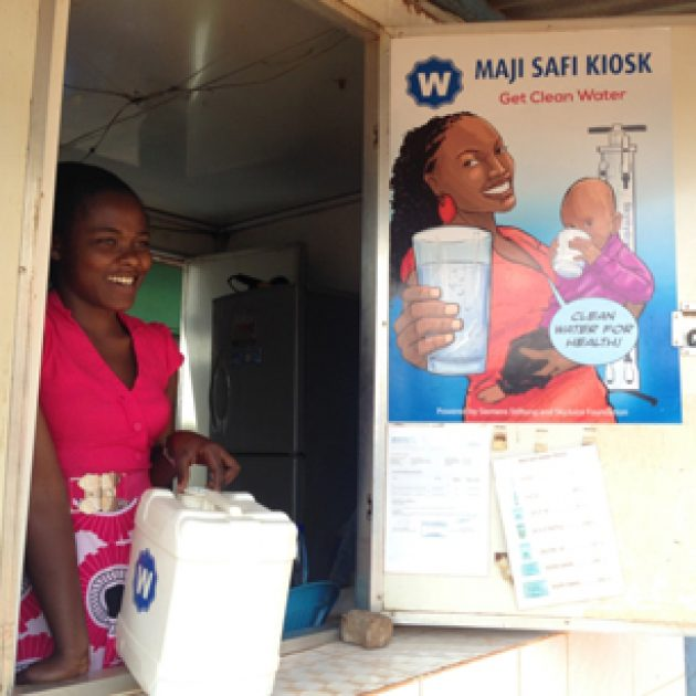 Buying water at a Maji Safi Kiosk